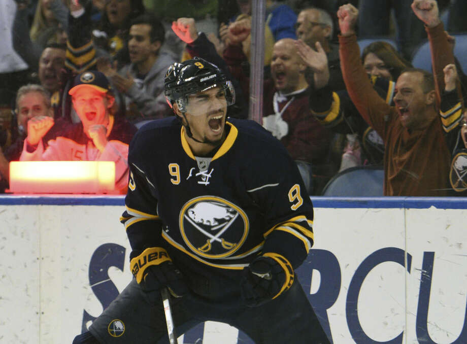 FILE - In this Dec. 4, 2015, file photo, Buffalo Sabres left winger Evander Kane celebrates a goal during the third period of an NHL hockey game against the Arizona Coyotes, in Buffalo, N.Y. On Monday, Dec. 28, 2015, Kane said he's done nothing wrong and is looking forward to clearing his name after being the subject of a sex offense investigation. (AP Photo/Gary Wiepert, File)