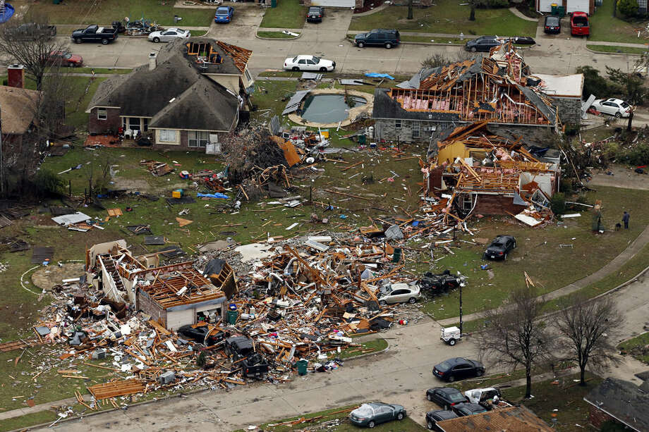 This aerial photo shows damage after a tornado ripped through the area, Monday, Dec. 28, 2015 in Glenn Heights Texas. Residents surveyed the destruction from deadly tornadoes in North Texas as the same storm system brought winter woes to the Midwest on Monday, amplifying flooding that's blamed for more than a dozen deaths and prompting hundreds of flight cancellations. At least 11 people died and dozens were injured in the tornadoes that swept through the Dallas area Saturday and caused substantial damage. (G.J. McCarthy/The Dallas Morning News via AP) MANDATORY CREDIT; MAGS OUT; TV OUT; INTERNET USE BY AP MEMBERS ONLY; NO SALES