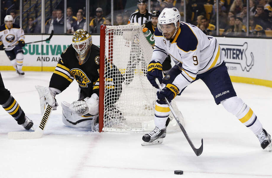 FILE - In this Dec. 26, 2015, file photo, Buffalo Sabres' Evander Kane (9) handles the puck behind Boston Bruins' Jonas Gustavsson (50) during the first period of an NHL hockey game in Boston. On Monday, Dec. 28, 2015, Kane said he's done nothing wrong and is looking forward to clearing his name after being the subject of a sex offense investigation. (AP Photo/Michael Dwyer, File)