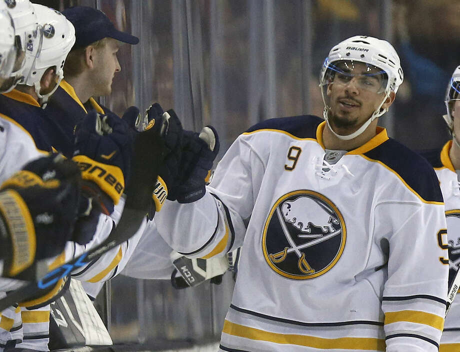FILE - In this Dec. 26, 2015, file photo, Buffalo Sabres' Evander Kane (9) celebrates his goal during the second period of an NHL hockey game against the Boston Bruins in Boston. On Monday, Dec. 28, 2015, Kane said he's done nothing wrong and is looking forward to clearing his name after being the subject of a sex offense investigation. (AP Photo/Michael Dwyer, File)