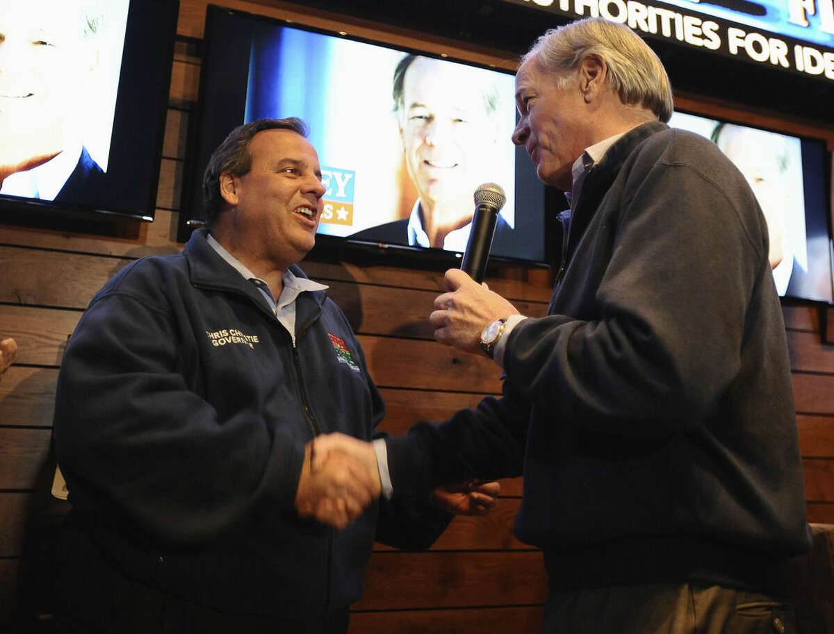 New Jersey Gov. Chris Christie, left, shakes hands with Republican candidate for Connecticut governor Tom Foley at a rally, Monday, Nov. 3, 2014, in Windsor Locks, Conn. (AP Photo/Jessica Hill)