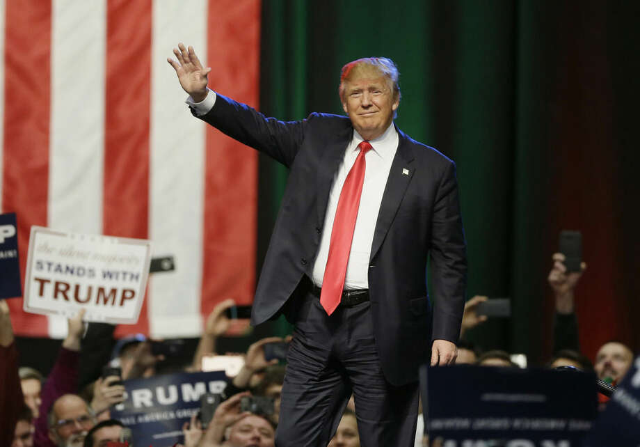 FILE - In this Dec. 21, 2015 file photo, Republican presidential candidate businessman Donald Trump acknowledges the crowd before speaking in Grand Rapids, Mich. The presidential election cycle is at a point when speculation starts swirling that the primaries won't produce a clear winner and one of the parties' big nominating conventions will dissolve in chaos. (AP Photo/Carlos Osorio, File)