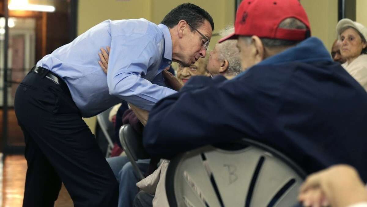 Connecticut Gov. Dannel Malloy kisses a resident during a campaign rally at the Bella Vista assisted living community in New Haven, Conn., Monday, Nov. 3, 2014. Malloy faces Republican candidate for governor Tom Foley in Tuesday's general election. (AP Photo/Charles Krupa)