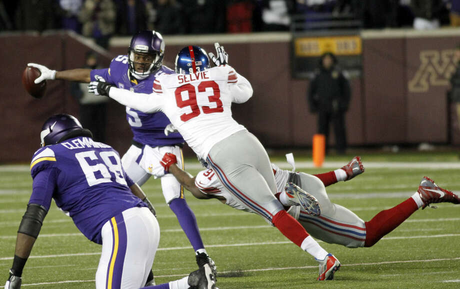 Minnesota Vikings quarterback Teddy Bridgewater (5) is sacked by New York Giants defensive ends George Selvie (93) and Robert Ayers (91) during the first half of an NFL football game, Sunday, Dec. 27, 2015, in Minneapolis. (AP Photo/Andy Clayton-King)