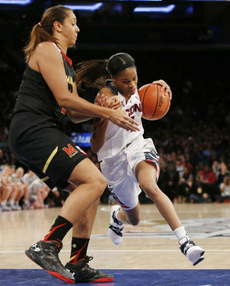 Connecticut guard Moriah Jefferson, right, drives past Maryland center Malina Howard during the first half of an NCAA college basketball game at Madison Square Garden in New York, Monday, Dec. 28, 2015. (AP Photo/Kathy Willens)