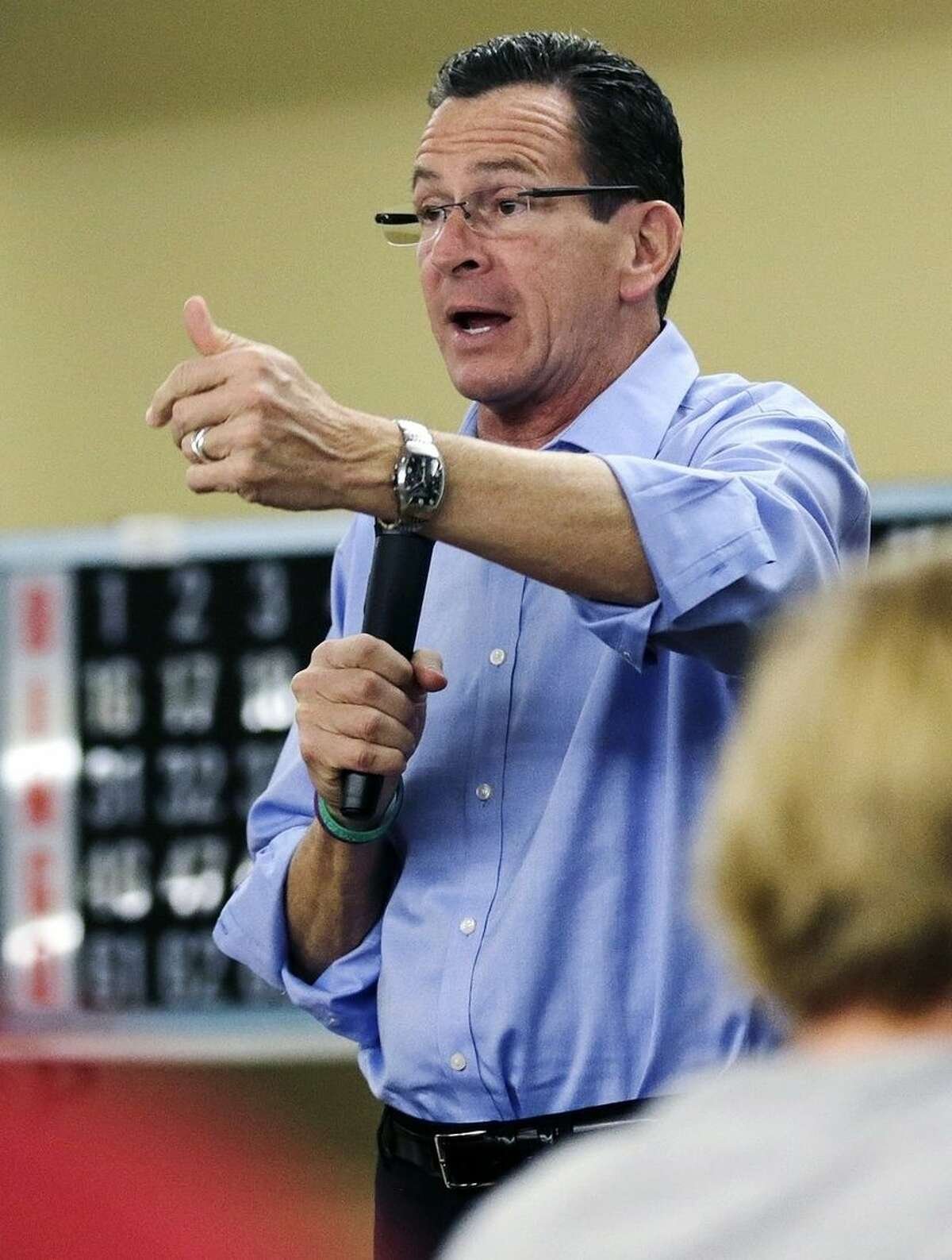 Connecticut Gov. Dannel Malloy gestures during a campaign rally at the Bella Vista assisted living community in New Haven, Conn., Monday, Nov. 3, 2014. Malloy faces Republican candidate for governor Tom Foley in Tuesday's general election. (AP Photo/Charles Krupa)