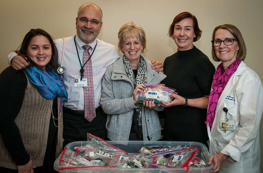 Pictured left to right: Katherine Soto, coordinator, Norwalk Hospital Foundation, Richard Zelkowitz, M.D., medical director, The Smilow Family Breast Health Center, Janet Kiehn, breast cancer survivor, Lori Snow, chairperson, Westport Young Women's League Community Service Committee, and Mary Heery, APRN, breast health specialist, The Smilow Family Breast Health Center at Norwalk Hospital.