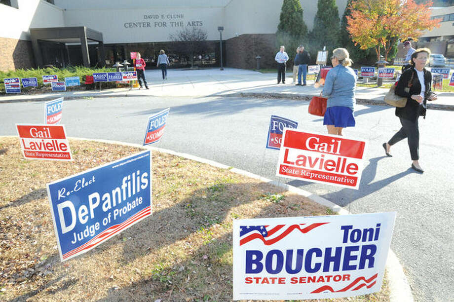 Residents in Wilton arrive at the Clune Center for the Arts at Wilton High School to cast ballots on Tuesday. Photo/Matthew Vinci