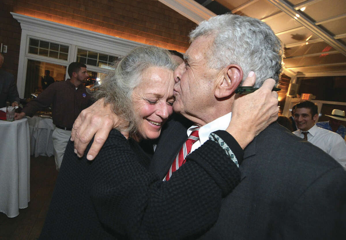 Hour photo/Alex von Kleydorff Tony DePanfilis gets a hug and gives his wife, Kelly, a big kiss on election night.