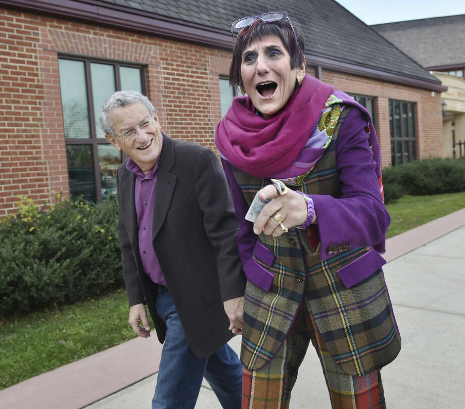 Rep. Rosa DeLauro, D-Conn., and her husband, political strategist Stan Greenberg, arrive to vote at Celentano Biotech, Health and Medical Magnet School on Canner Street in New Haven, Conn. on Tuesday, Nov. 4, 2014. (AP Photo/New Haven Register, Catherine Avalone)