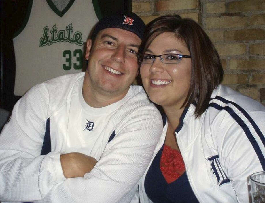 In this March 6, 2012 photo provided by Rochelle Carrasco, she and Jeremy Jehnsen pose at the Nuthouse Sports Grill in Lansing, Mich. The couple is getting married in Lansing on Dec. 31, 2015, and they'll be having their first dance around the same time as the kickoff of the Michigan State-Alabama New Year's Eve matchup in the College Football Playoff semifinals. (Rochelle Carrasco via AP)