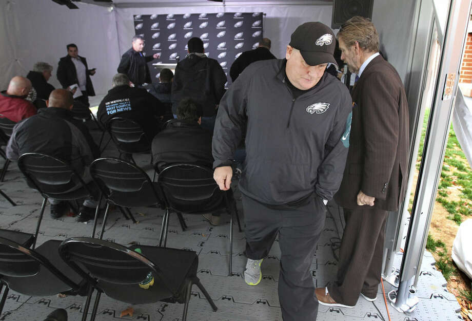 Philadelphia Eagles coach Chip Kelly leaves a news conference Monday, Dec. 28, 2015, in Philadelphia. Less than 48 hours after quarterback Sam Bradford said he wanted to be back with the Eagles, Kelly said he wanted his quarterback to return. (Michael Bryant/The Philadelphia Inquirer via AP)