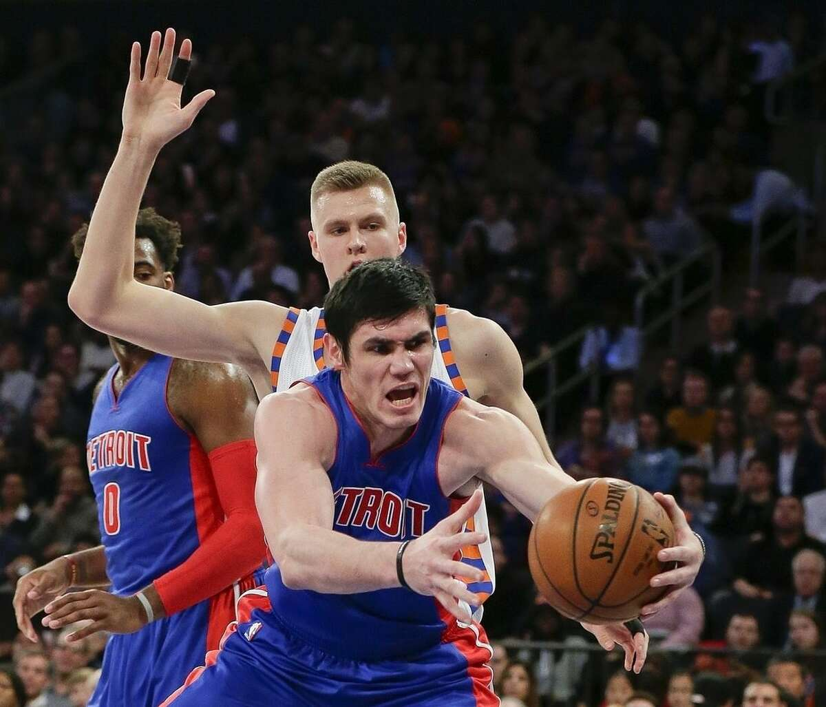 Detroit Pistons' Ersan Ilyasova, right, fights for the ball with New York Knicks' Kristaps Porzingis during the first half of an NBA basketball game Tuesday, Dec. 29, 2015, in New York. (AP Photo/Frank Franklin II)