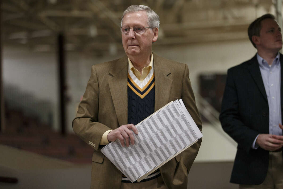 Senate Minority Leader Mitch McConnell, R-Ky., prepares to cast his ballot in the midterm election at the voting precinct at Bellarmine University in Louisville, Ky., Tuesday, Nov. 4, 2014. The Kentucky U.S. Senate race, with McConnell, a 30-year incumbent, facing a spirited challenge from Democrat Alison Lundergan Grimes, has been among the most combative and closely watched contests that could shift the balance of power in Congress. (AP Photo/J. Scott Applewhite)