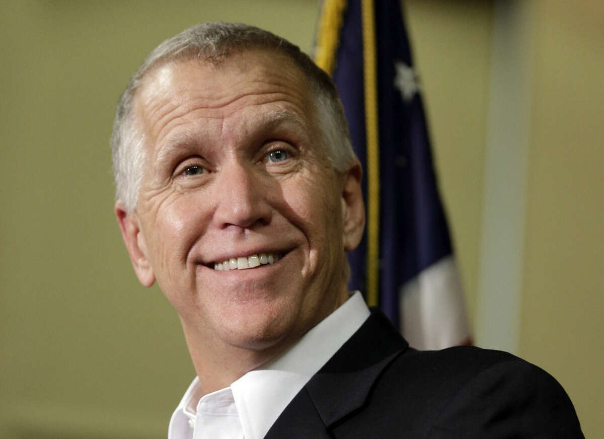 U.S. Sen.-elect Thom Tillis, R-N.C., smiles as he answers a question from the media during a news conference in Charlotte, N.C., Wednesday, Nov. 5, 2014. Tillis unseated Democratic Sen. Kay Hagan in Tuesday's election, narrowly winning a race that attracted more than $100 million in spending from the candidates and outside groups and that proved to clinch the Senate majority for the GOP. (AP Photo/Chuck Burton)