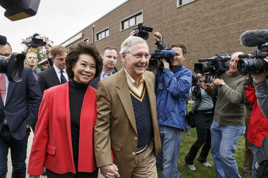 Senate Minority Leader Mitch McConnell of Ky., and his wife, former Labor Secretary Elaine Chao, leave after casting their ballots in the midterm election at the voting precinct at Bellarmine University in Louisville, Ky., Tuesday, Nov. 4, 2014. The Kentucky Senate race, with McConnell, a 30-year incumbent, facing a spirited challenge from Democrat Alison Lundergan Grimes, has been among the most combative and closely watched contests that could shift the balance of power in Congress. (AP Photo/J. Scott Applewhite)