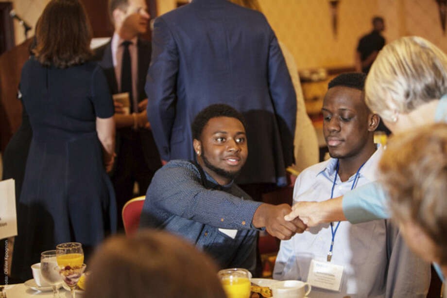 Contributed photoMarcus Stovall, Thrive by 25 Ambassador, shakes hands at a recent event.