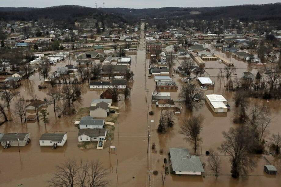 This photo shows a northern view of 1st Street where homes were flooded on Tuesday, Dec. 29, 2015, in Pacific, Mo. Torrential rains over the past several days pushed already swollen rivers and streams to virtually unheard-of heights in parts of Missouri and Illinois. (J.B. Forbes /St. Louis Post-Dispatch via AP) EDWARDSVILLE INTELLIGENCER OUT; THE ALTON TELEGRAPH OUT; MANDATORY CREDIT