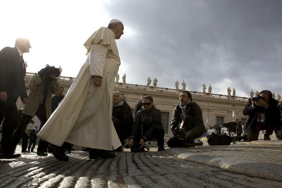 Pope Francis arrives for his weekly general audience in St. Peter's Square at the Vatican, Wednesday, Nov. 5, 2014. (AP Photo/Alessandra Tarantino)
