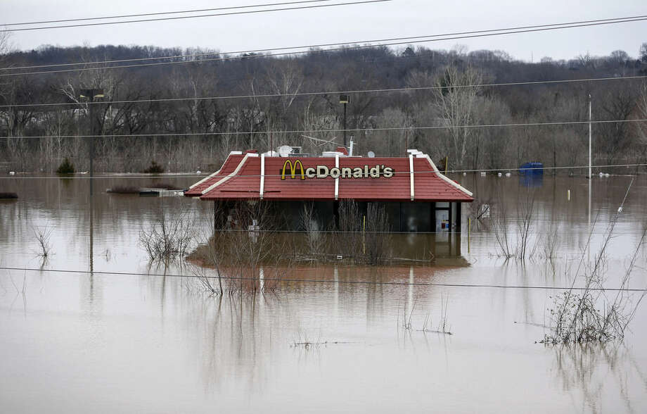 Floodwater from the Bourbeuse River surrounds a McDonald's restaurant, Tuesday, Dec. 29, 2015, in Union, Mo. Torrential rains over the past several days pushed already swollen rivers and streams to virtually unheard-of heights in parts of Missouri and Illinois. (AP Photo/Jeff Roberson)