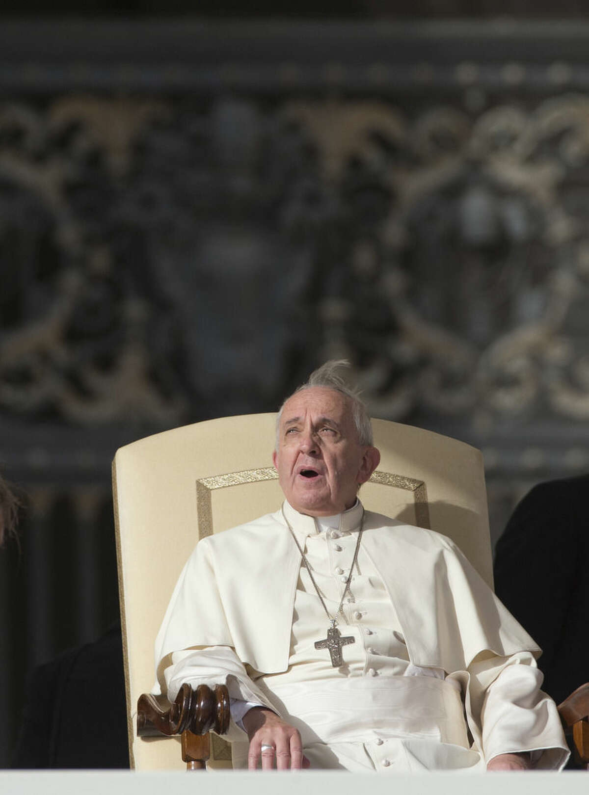 Pope Francis looks up as he arrives for his weekly general audience in St. Peter's Square at the Vatican, Wednesday, Nov. 5, 2014. (AP Photo/Alessandra Tarantino)