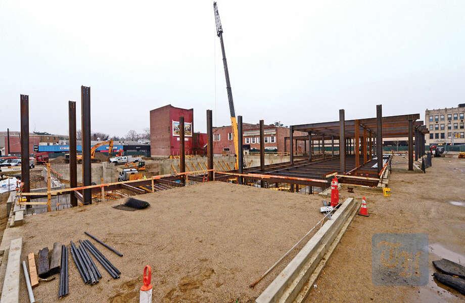 Hour photo / Erik Trautmann The Poko Development on Wall St begins to take shape.