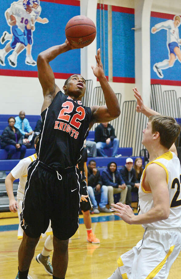 Hour photo / Erik Trautmann Stamford High School Boys Basketball player # 22 Steffan Harding goes up for the shot against Weston during holiday tournament play at Brien McMahon High School in Norwalk Wednesday night.