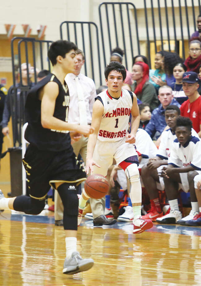 Brien McMahon's Brendan Quinlan-Huertas dribbles the ball during a home Championship game for the Kuczo Holiday Tournament against Barlow Wednesday evening. Hour Photo / Danielle Calloway