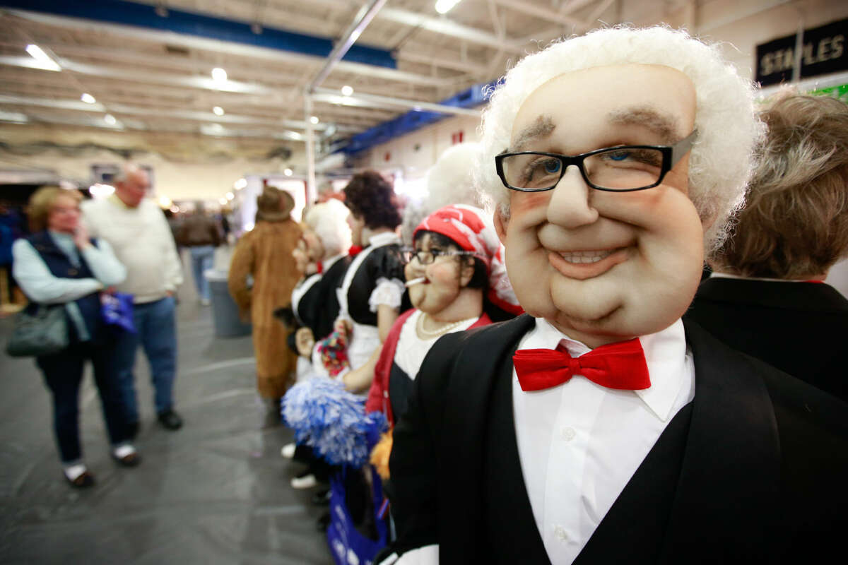 Hour photo/Chris Palermo. Lifesized stuffed people sit on display at the People for Sale booth at the CraftWestport pop-up marketplace at Staples High School Saturday.
