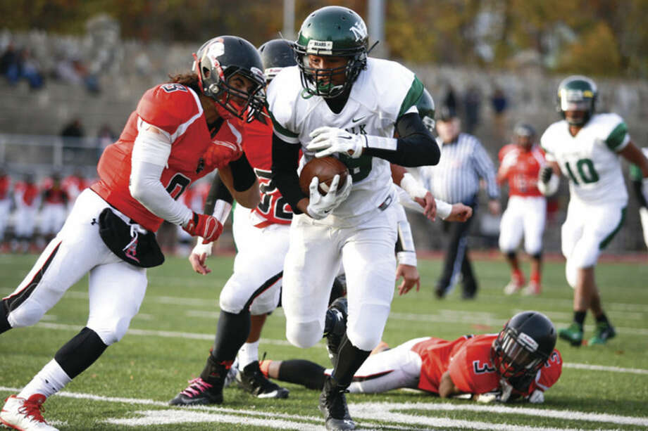 Hour photo/Chris PalermoNorwalk's Izaiah Sanders braces for impact during the Bears' 24-22 victory over Stamford Saturday.