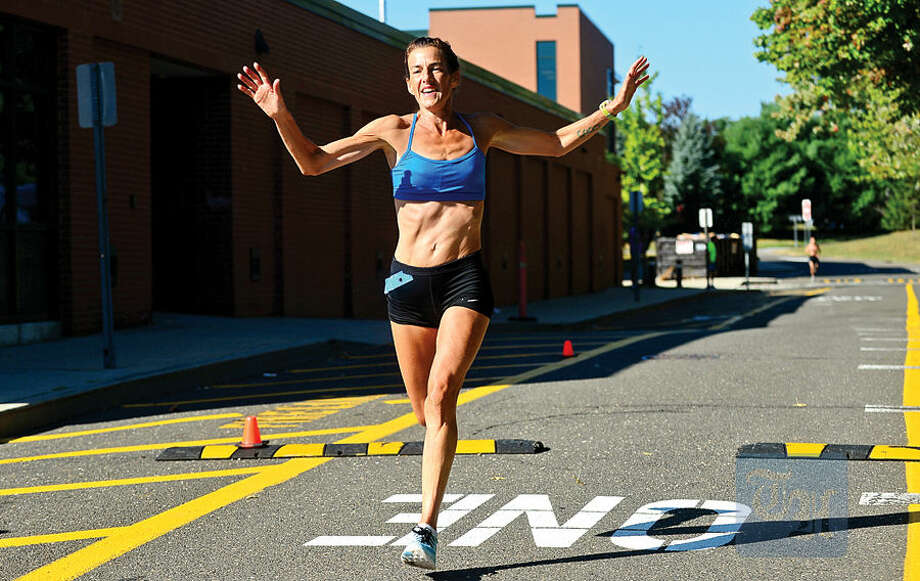 Hour photo / Erik Trautmann Mary Zengo breaks the course recond for women with a time of 1:03:25 in the Westport Road Runners Summer Series 10-mile race Saturday at Staples High School.