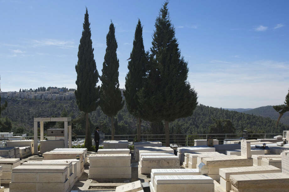 An ultra-Orthodox Jewish man stands at a cemetery during the funeral of 17-year-old student Shalom Baadani, in Jerusalem, Friday, Nov. 7, 2014. Baadani was wounded in an attack in Jerusalem on Wednesday and died of his wounds on Friday. (AP Photo/Sebastian Scheiner)