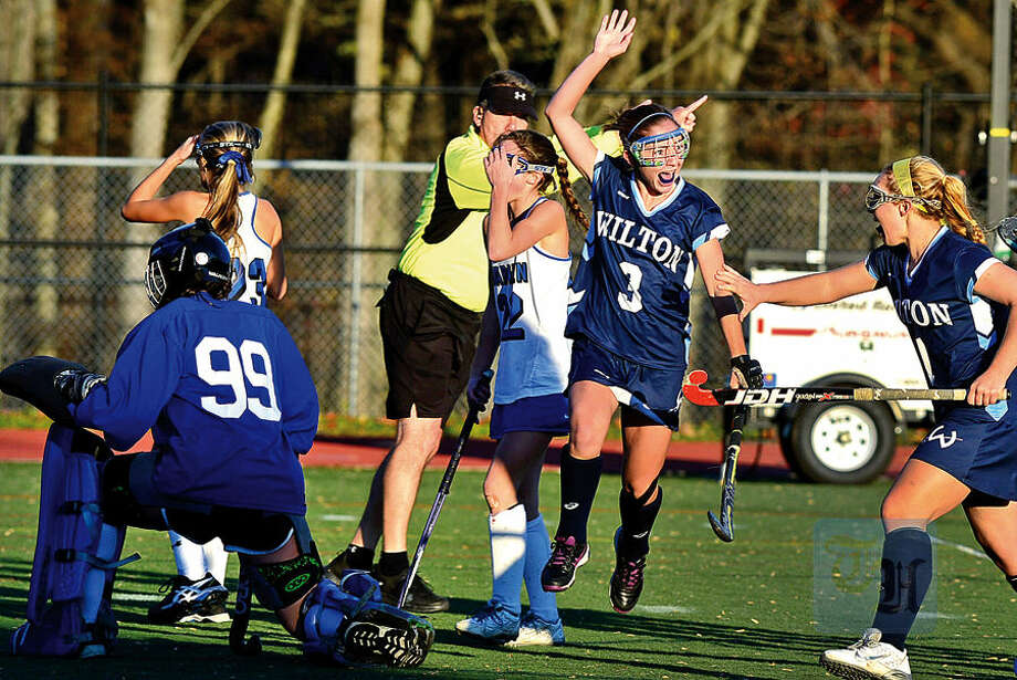 Hour photo / Erik Trautmann Wilton High School's Emma Rosen reacys after scoring the winning goal in sudden death overtime against Darien High School in their CIAC state tournament quarterfinal Friday in Darien.