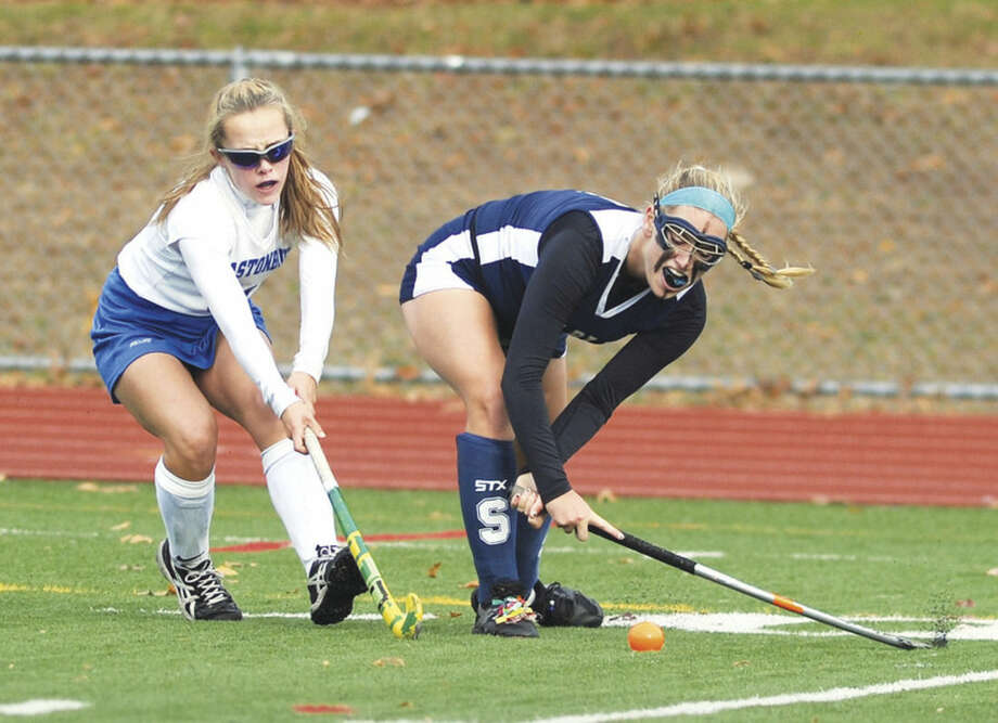 Hour photo/John NashStaples' Jenna McNicholas, right, hits the ball up field against Glastonbury defender Bryn Murray during Friday's CIAC Class L quarterfinal in Glastonbury.