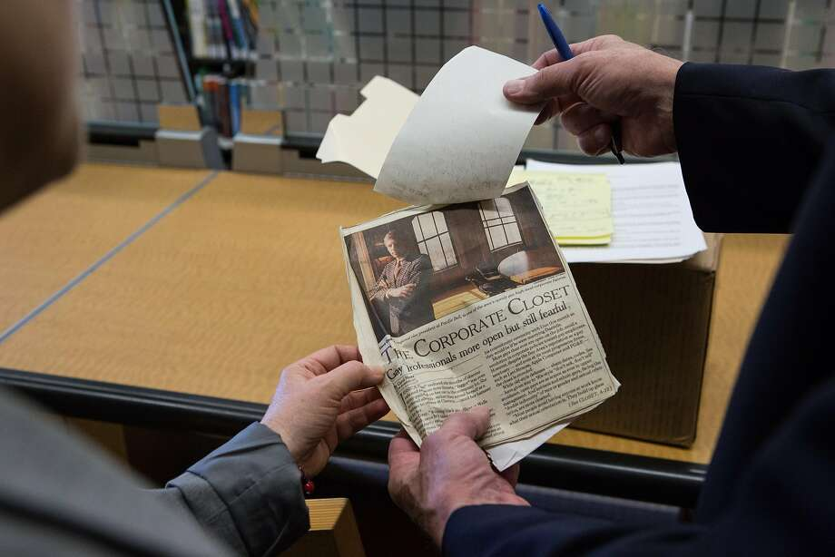 Steve Coulter shows Hormel Center director Karen Sundheim the newspaper clipping of when he was featured in the SF Examiner for being an out openly gay business man on Friday, June 10, 2016. Photo: Amy Osborne, Special To The Chronicle