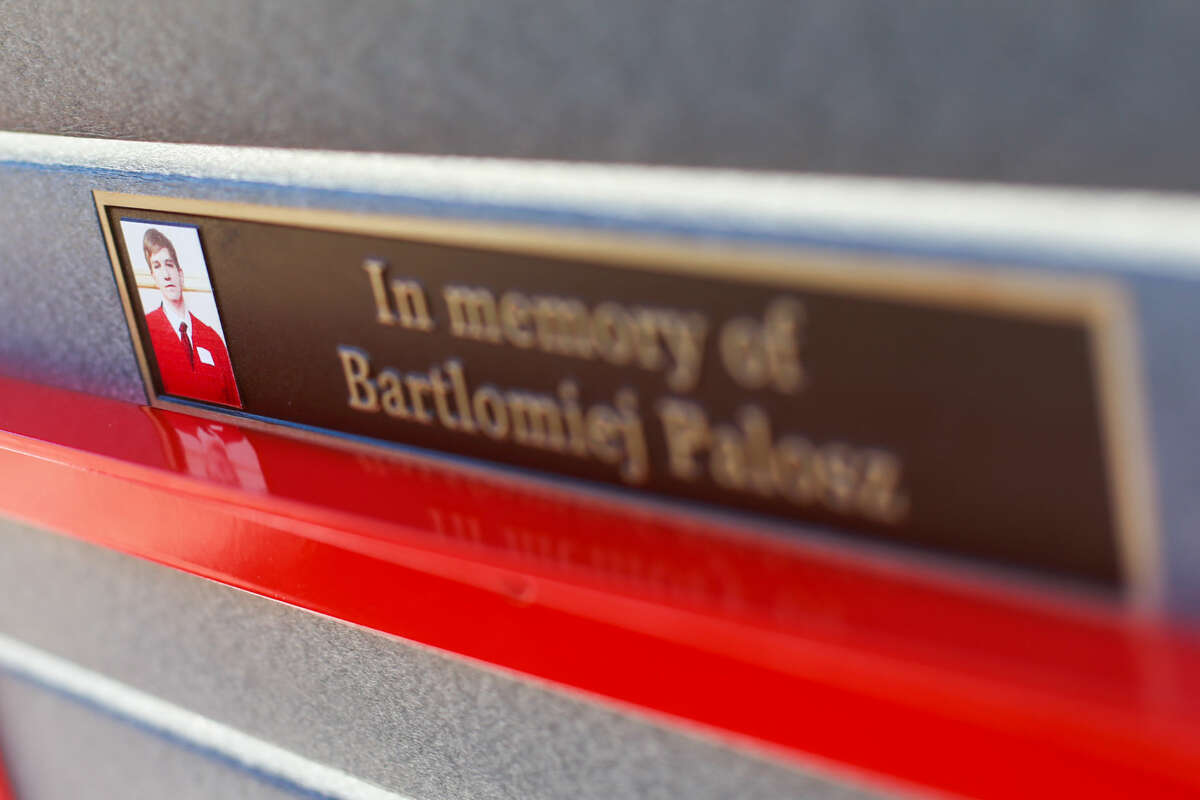 Hour photo/Chris Palermo. A plaque is placed on the back of the