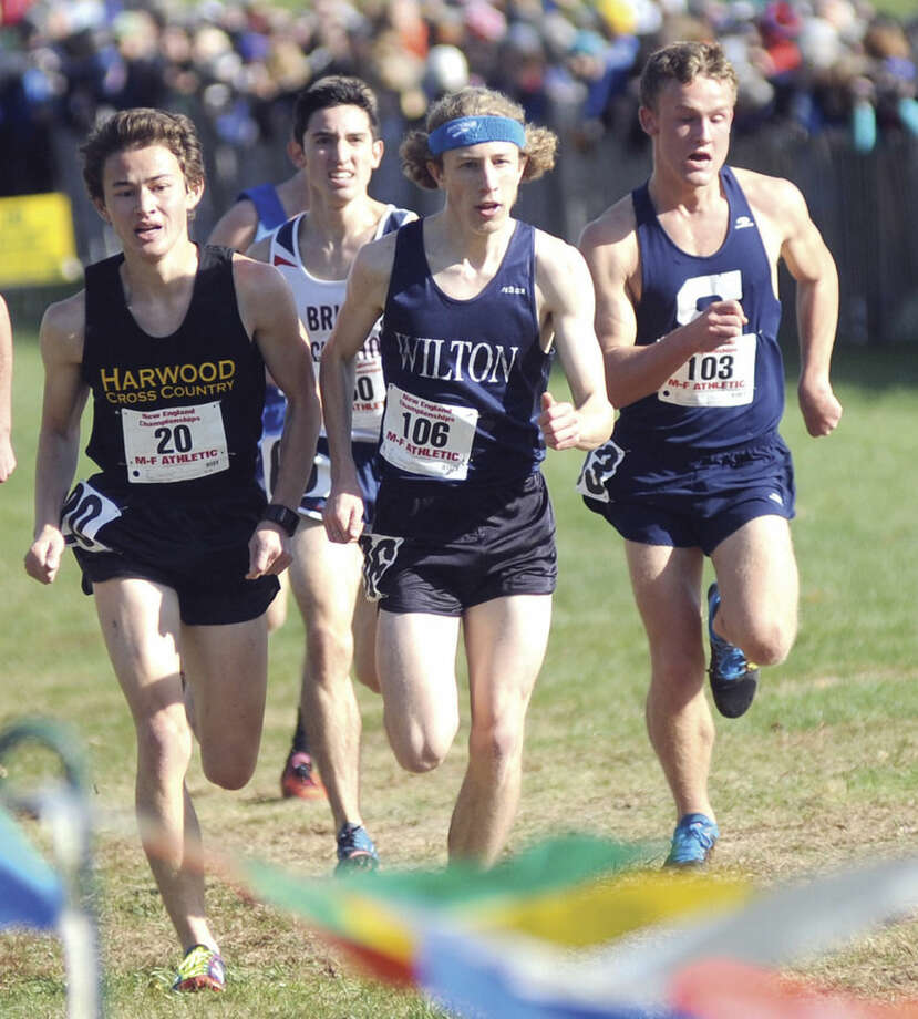 Hour photo/John NashLocal runners Eric van der Els, rear, of Brien McMahon; Spencer Brown of Wilton (106) and Staples' Oliver Hickson (103) push toward the finish along side Sam Nishi of Harwood Union, Vt., during the New England cross country championship meet at Wickham Park in Manchester on Saturday. All four runners posted top 15 finishes.
