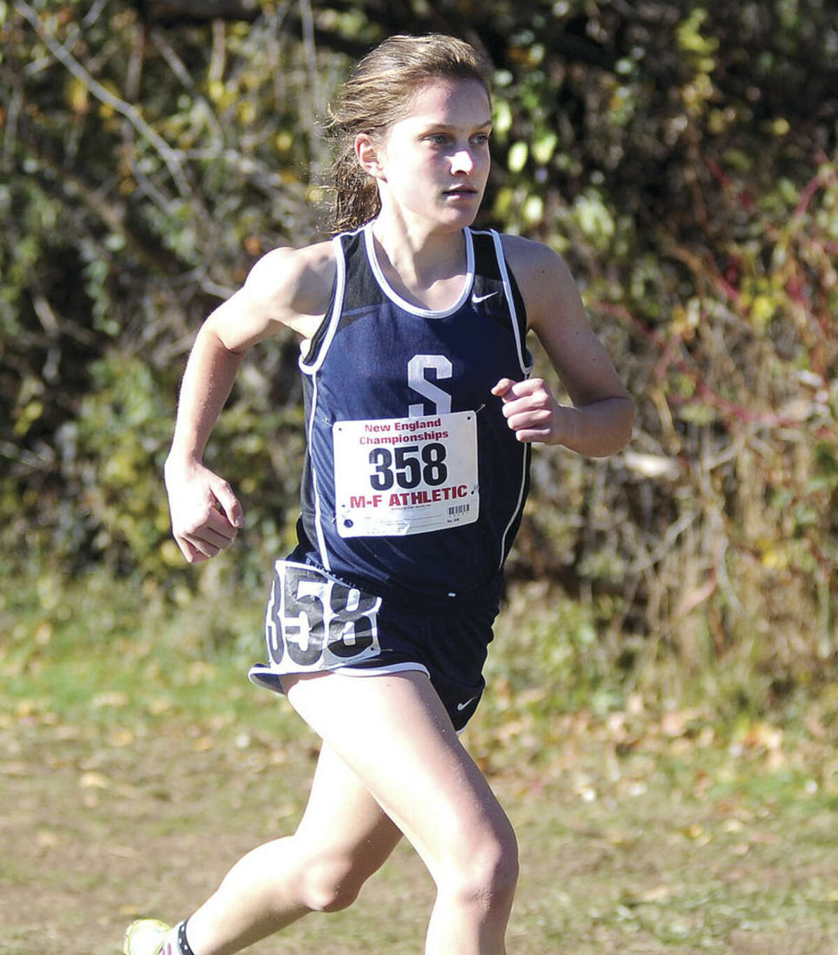 Hour photo/John Nash Staples High junior Hannah DeBalsi ran to her second straight New England cross country championship on Saturday at Wickham Park in Manchester.