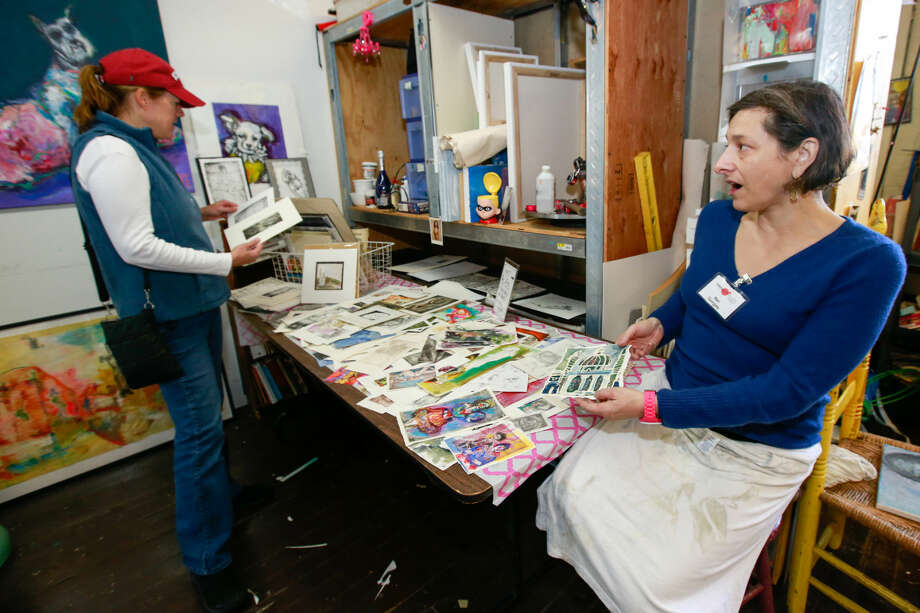 Hour photo/Chris Palermo. Mari Gyorgyey shows off some of her art in her studio at Firing Circuits Open Studios and Gallery Show in Norwalk Saturday.