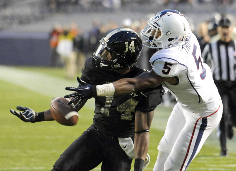 Army defensive back Chris Carnegie, left, breaks up a pass intended for Connecticut wide receiver Noel Thomas during the first half of a college football game Saturday, Nov. 8, 2014, at Yankee Stadium in New York. (AP Photo/Bill Kostroun)