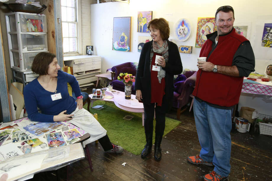 Hour photo/Chris Palermo. Mari Gyorgyey shares a laugh in her studio with artist Nany Woodward at Firing Circuits Open Studios and Gallery Show in Norwalk Saturday.