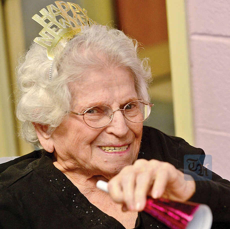 Hour photo / Erik Trautmann Notre Dame Convalescent Home residents including Margaret DeMartino take part in the facility's New Year's celebration Thursday afternoon.