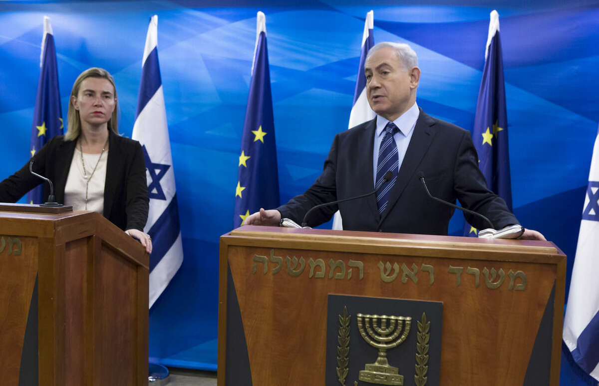 Israeli Prime Minister Benjamin Netanyahu makes an opening statement in his Jerusalem offices as he meets with EU Foreign Affairs and Security Policy Federica Mogherini, left, in Jerusalem, Friday, Nov. 7, 2014. (AP Photo/Jim Hollander, Pool)