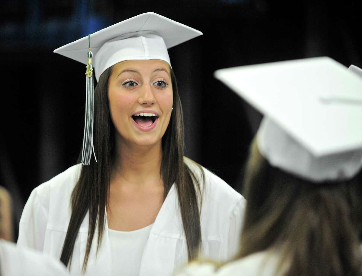 Angela Marie Haglund reacts to a class mate while they wait for the start of the New Milford High School 2016 Graduation Exercise, on June 11, 2016, at the O'Neill Center, Western Connecticut State University, Danbury, Conn.