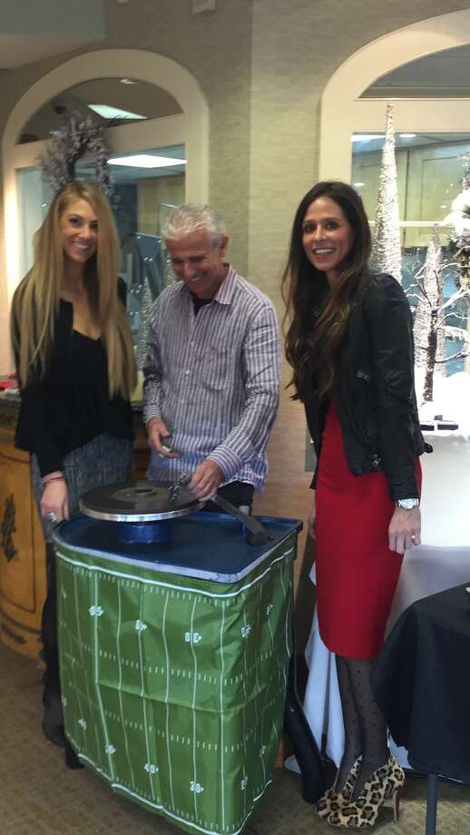Lauren Hogan and Alyssa Dinello from Becker's Diamonds and Fine Jewelry watch professional Diamond Cutter Boris Wachterman transform uncut stones into dazzling diamonds at Becker's exclusive Diamond Vault Event that was held on December 4th and 5th in West Hartford.