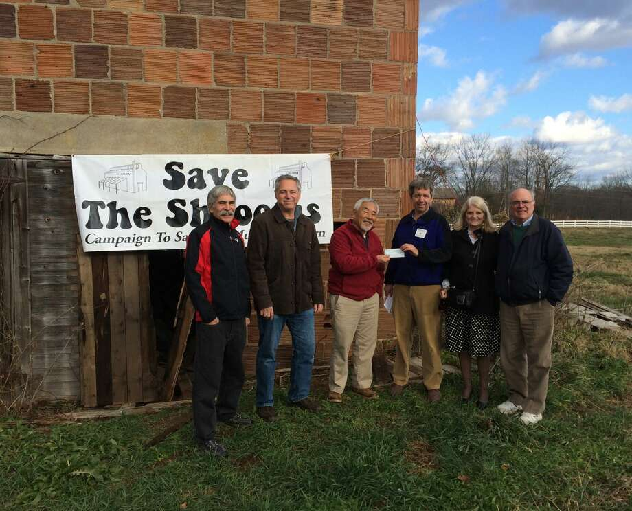 "To help preserve the 100-year-old Mushroom Barn at Auerfarm, the Bloomfield Rotary donated $5,000 to the ""Save the 'Shrooms"" restoration project. From left; Dale Bertoldi, Architect from Ironwood Community Partners, Mark Weisman, Board Member of the 4-H Education Center at Auerfarm and Architect from Tangible Properties, Jack Hasegawa, Executive Director of the 4-H Education Center at Auerfarm, Jonathan Hochman, President of the Bloomfield Rotary Club, Hans Kilbourn, member of the Bloomfield Rotary Club, and Norman Famely, President of the Bloomfield Rotary Club Foundation. Photo courtesy of Alliances by Alisa Media Relations."