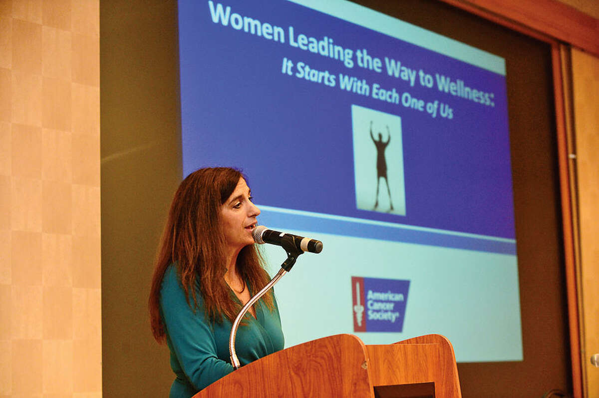 Hour photo / Erik Trautmann Health and Wellness Life Coach Nina Antolino welcomes guests as The American Cancer Society hosts the inaugural