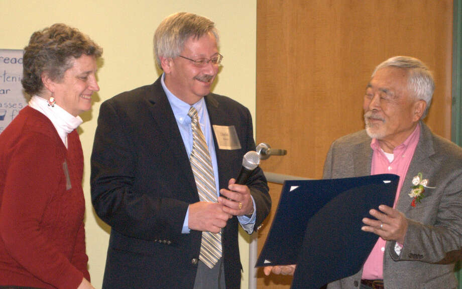 From left, CT State Senator Beth Bye and CT State Representative David Baram present a certificate from the Connecticut State Legislature to retiring Executive Director of the 4-H Education Center at Auerfarm, Jack Hasegawa, in recognition of his accomplishments as leader of the farm. A party was held to honor Hasegawa's retirement on December 12th at Auerfarm in Bloomfield.
