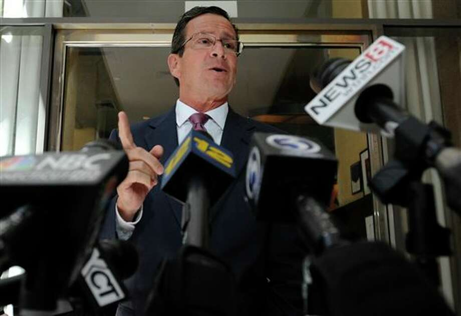 Connecticut Gov. Dannel P. Malloy briefly speaks to the media after stopping by a restaurant to welcomeTexas Gov. Rick Perry in Hartford, Conn., Monday, June 17, 2013. Perry was at the restaurant hosting a lunch appointment with Connecticut gun makers. The governors of Texas and South Dakota are visiting Connecticut to court local gun makers, many of which have threatened to leave since the state passed tough new gun-control laws in response to the massacre at Sandy Hook Elementary School. / FR125654 AP