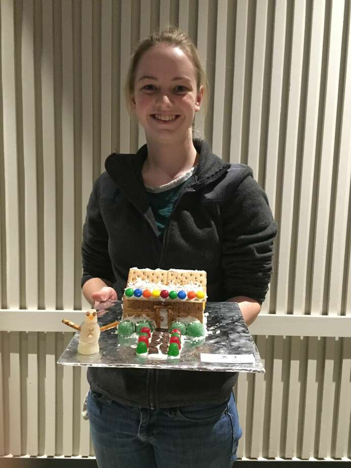 Jessie Huffman displays her gingerbread creation to support Habitat for Humanity.